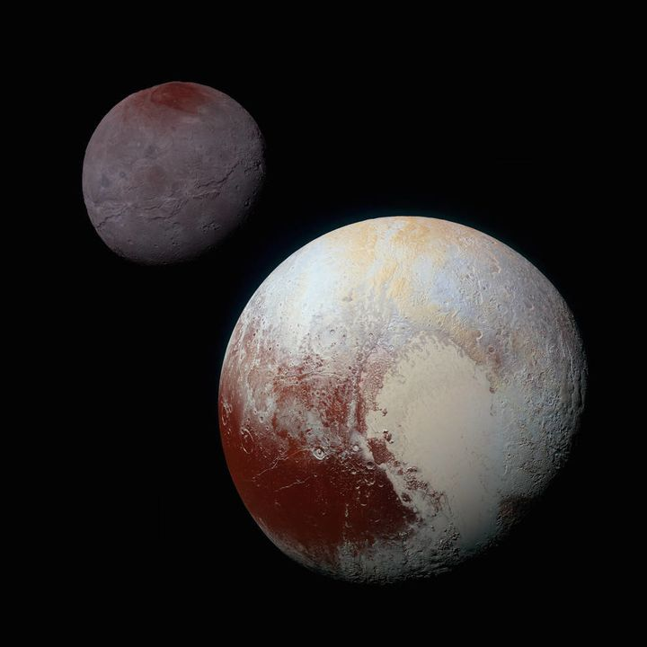This composite of enhanced-color images of Pluto (lower right) and Charon (upper left) was taken by NASA's New Horizons space