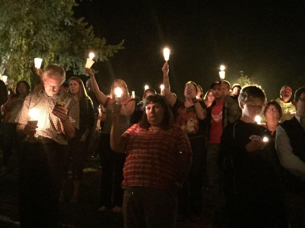 Members of the Roseburg, Oregon community gather for a vigil following a horrific shooting at Umpqua Community College.