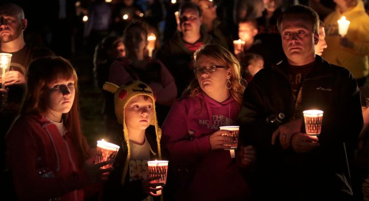 People gather at a vigil in Roseburg, Oregon, after the Oct. 1 shooting at Umpqua Community College.