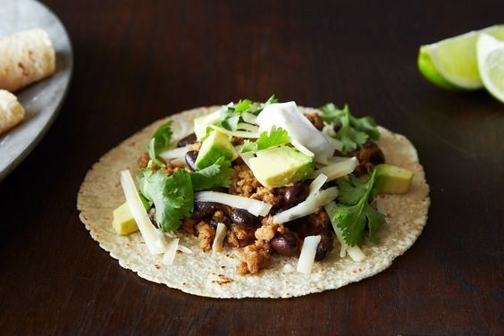 """<strong>Get the <a href=""""http://food52.com/recipes/22184-coconut-lime-pork-tacos-with-black-beans-and-avocado"""" target=""""_blank"""