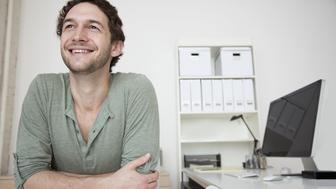Caucasian businessman sitting at desk