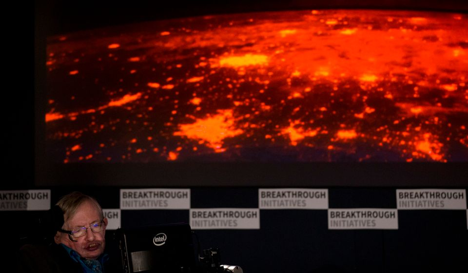 Renowned physicist Stephen Hawking sits in front of a presentation image during a press conference in London, Monday, July 20
