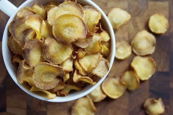 Kale chips are so last year (just kidding, they're really delicious), but parsnip chips are easier to make and will give you