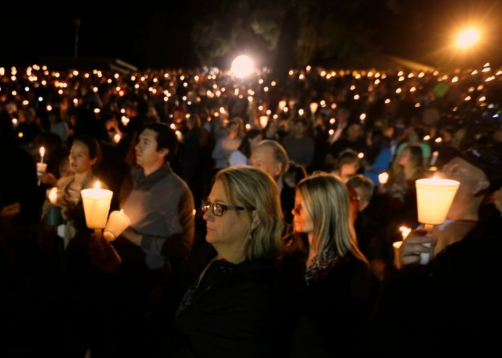 Community members gather for a vigil for those killed in a shooting at Umpqua Community College in Roseburg, Oregon on Oct. 1