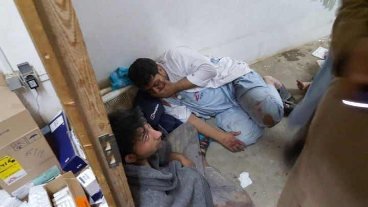 Doctors Without Borders staff huddle together after a U.S. airstrike on a hospital in Kunduz, Afhanistan on Oct. 3, 2015.