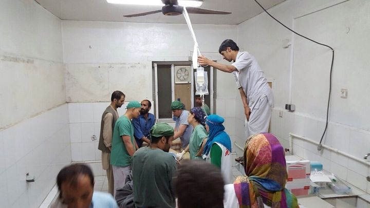 Doctors Without Borders (MSF) staff are seen during a surgery after a US airstrike on MSF hospital in Kunduz, Afghanistan on