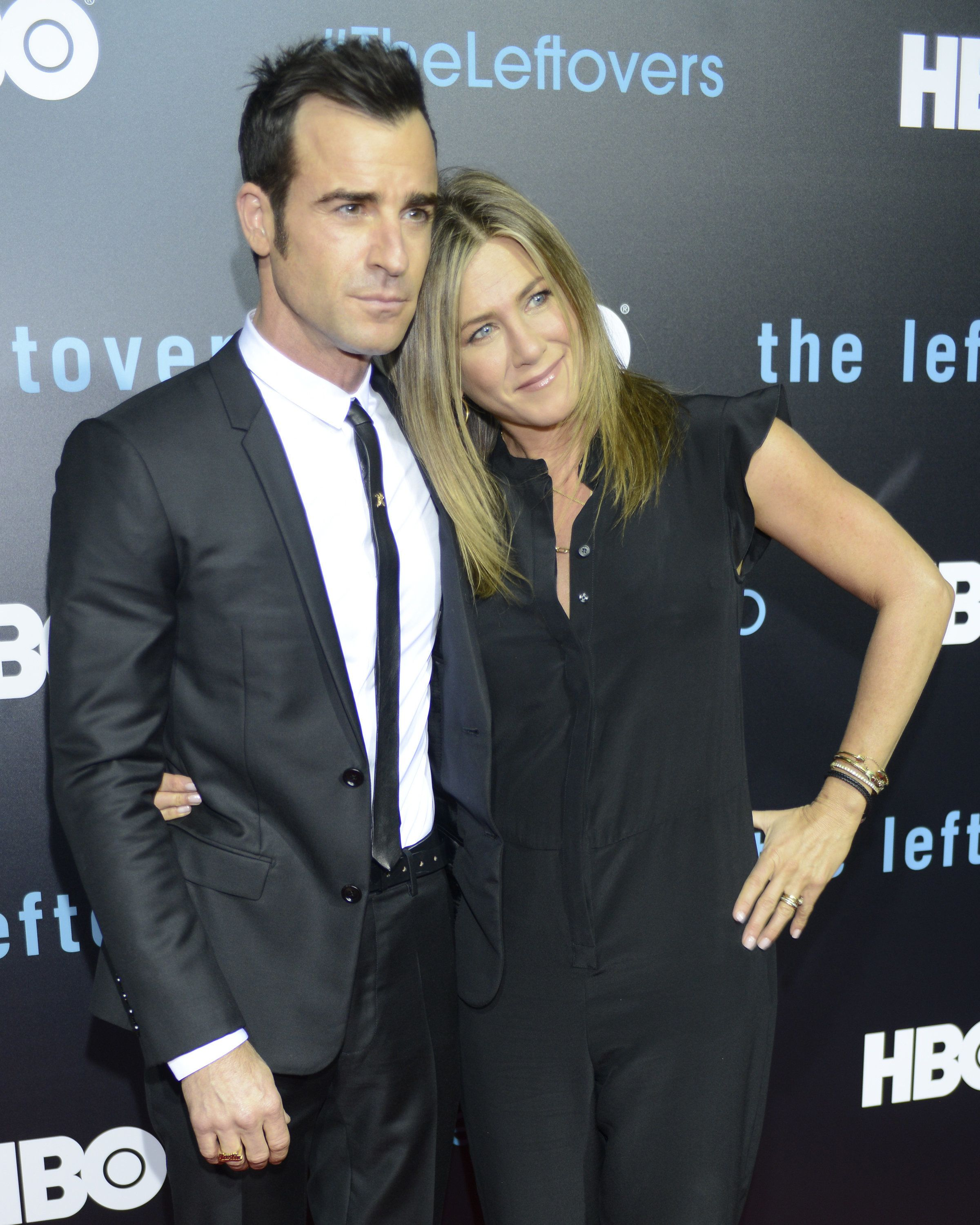 AUSTIN, TX - OCTOBER 03:  Justin Theroux (L) and Jennifer Aniston attend HBO's 'The Leftovers' Season 2 Premiere during The ATX Television Festival at the Paramount Theatre on October 3, 2015 in Austin, Texas.  (Photo by Tim Mosenfelder/Getty Images)