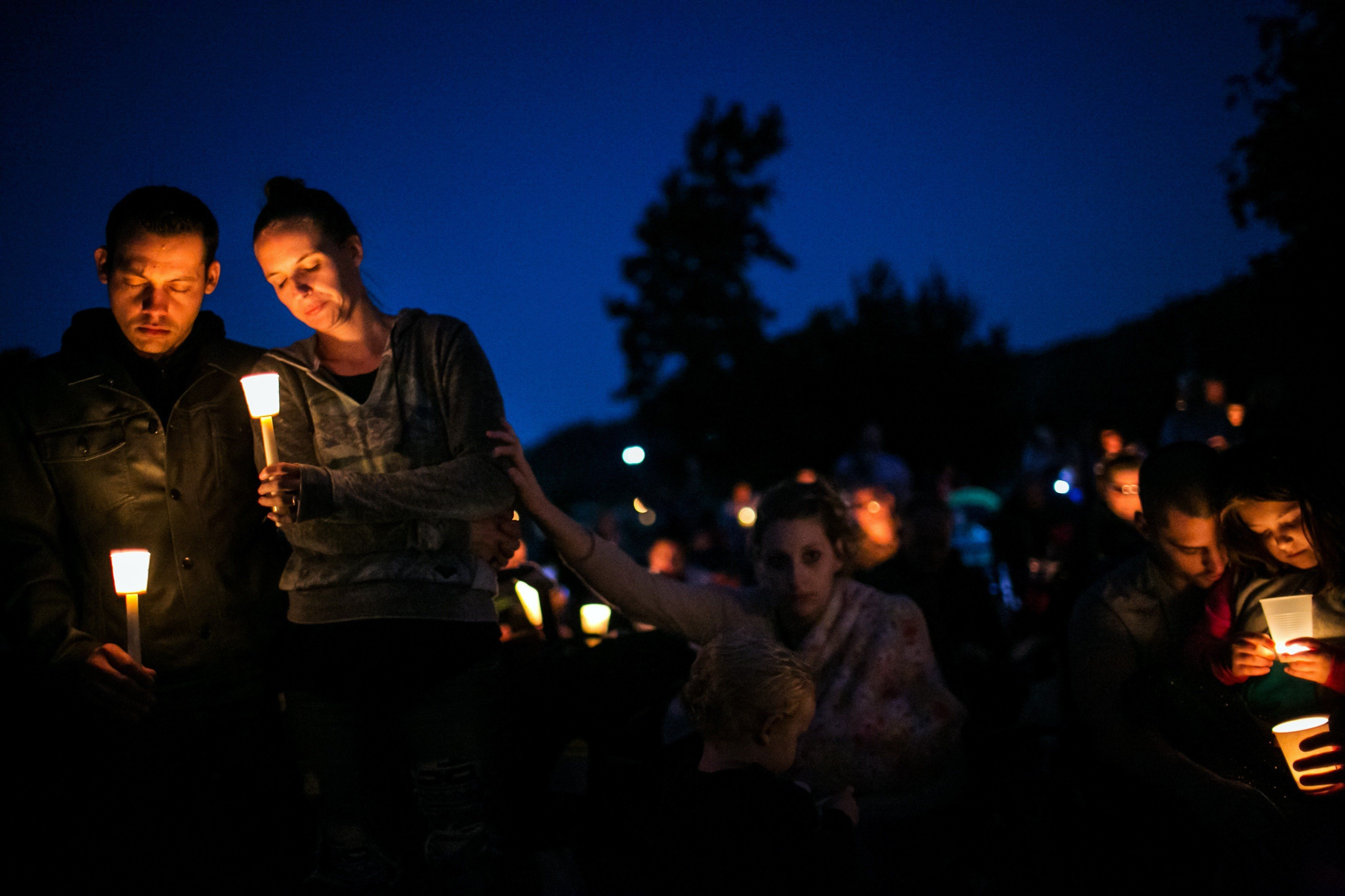 Community members attend a prayer service and candlelight vigil to remember the victims of the mass shooting at Umpqua Commun