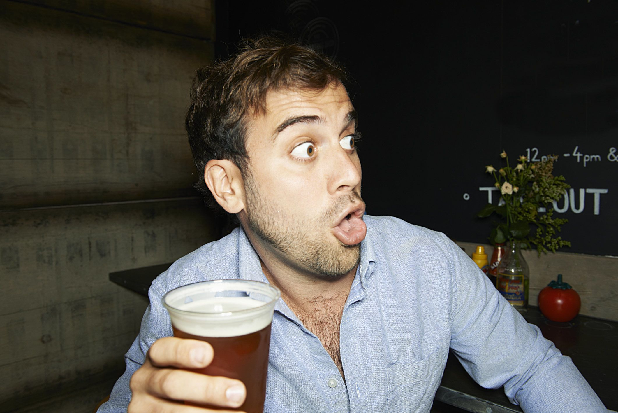 man on night out with beer