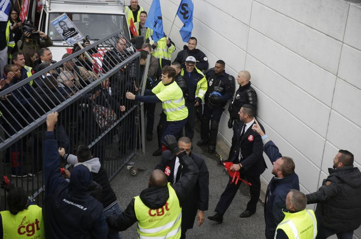 Demonstrators try to enter to Air France headquarters in Roissy-en-France, on Oct.5, 2015, during a demonstration for t