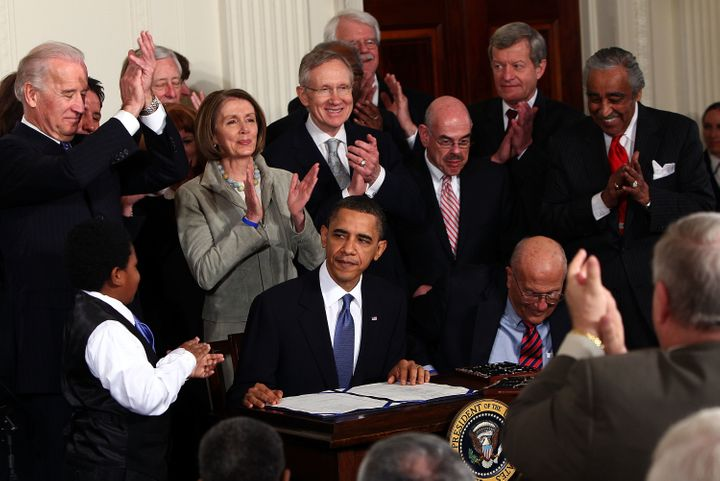 President Barack Obama signs the Affordable Care Act into law on March 23, 2010. He didn't pose for the media when he put his signature on this new health care bill.