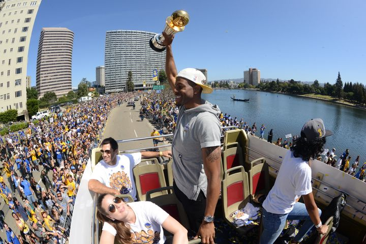 Golden State Warrior Andre Iguodala celebrates winning the Bill Russell Finals MVP award and the 2015 NBA titleduring h