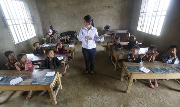 Vietnam --- Giang Thi May teaches a first-grade class at the primary school of Van Chai in Dong Van district, on the border w