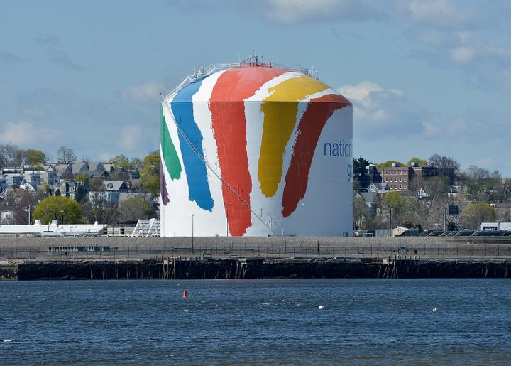 """A general view of """"Rainbow Swash"""" by artist Corita Kent, painted in 1971 on a 140-foot tall LNG storage tank in Boston. It is"""