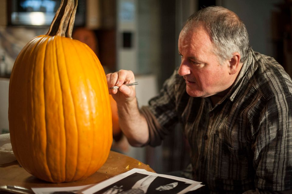 Artist Hugh McMahon carves Donald Trump into a pumpkin at his Brooklyn, New York studio on Monday Oct. 5, 2015.