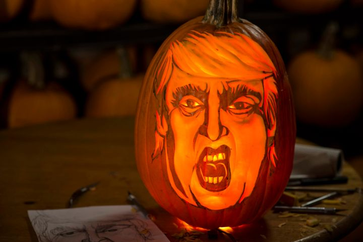 "The finished carving of Donald Trump in a pumpkin, what we're just going to call  a ""Trumpkin,"" took about an hour and a half -- carver Hugh McMahon illuminates most of his pumpkins with lightbulbs, rather than candles, for a more even glow."