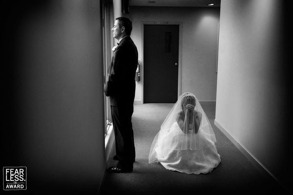 """Presenting this image in black & white stripped the scene down to the bride and groom, each left to his or her own thoug"