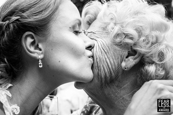 """Grandma! The emotion of a sweet smooch between generations is hard to resist, especially in a context as tradition- and fami"