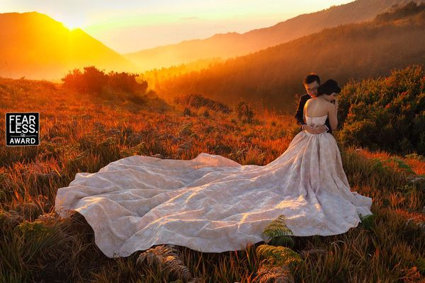 """Golden sunset light simply pours over this loving couple, giving the scene a soft, misty, and completely romantic look. And"