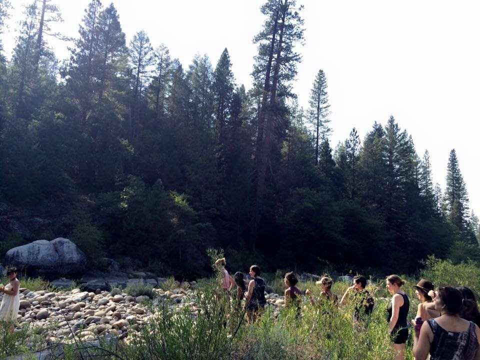 Sweet Water Women's Retreat participants process to the river for the weekend's opening ceremony. They meditated and made off