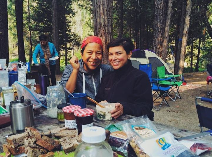 Dalila Mendez, left, and Andrea Penagos, right, enjoy a bountiful breakfast before a day of activity at the Sweet Water Women