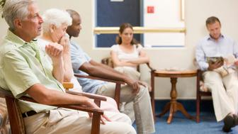 B3K3XX Five people waiting in waiting room Health; Healthcare; Care; Waiting; room; Waiting; Doctor; doctors; surgery; patients; waiting; waiting; room; Clinic; Health; Healthcare; Patient; Reading; Waiting; African; American; Appointment; Baby; Boomer; Blur; Depth; of; Field; Generation; X; Health; Care; Lifestyle; Magazine; Medical; Multi; Ethnic; Group; Old; Age; People; Woman; health; centre; practise; doctor; doctor's