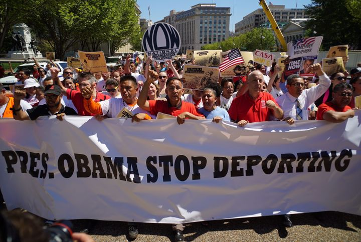 Immigrant rights activist march on Pennsylvania Avenue as they arrive at the White House on Aug. 28, 2014, in Washington