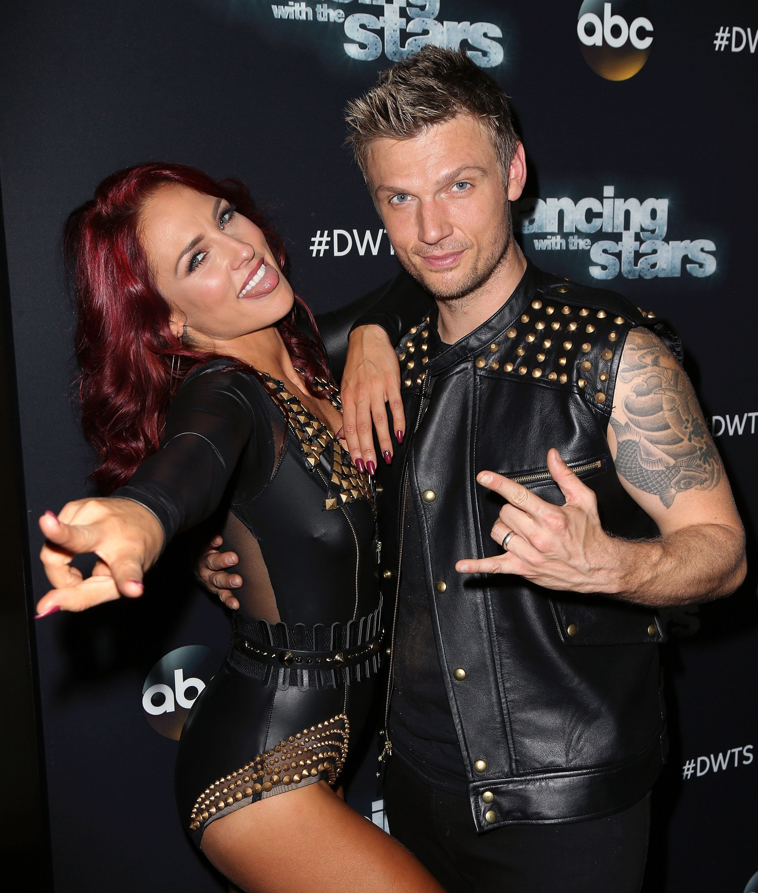 LOS ANGELES, CA - OCTOBER 05:  Singer Nick Carter (R) and dancer/TV personality Sharna Burgess attend 'Dancing with the Stars' Season 21 at CBS Televison City on October 5, 2015 in Los Angeles, California.  (Photo by David Livingston/Getty Images)