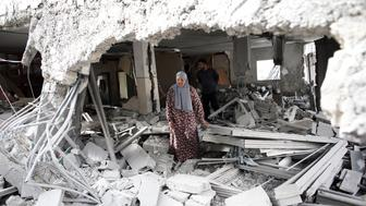 A Palestinian woman walks amid the rubble of a house after Israeli security forces demolished the homes of two Palestinians behind attacks in the Palestinian neighborhood of Jabal Mukaber in east Jerusalem, on October 6, 2015. Israeli Prime Minister Benjamin Netanyahu pledged an iron fist against mounting unrest. The houses knocked down were the former homes of Ghassan Abu Jamal and Mohammed Jaabis, they killed four rabbis and a policeman before being shot dead in November 2014. AFP PHOTO / THOMAS COEX        (Photo credit should read THOMAS COEX/AFP/Getty Images)