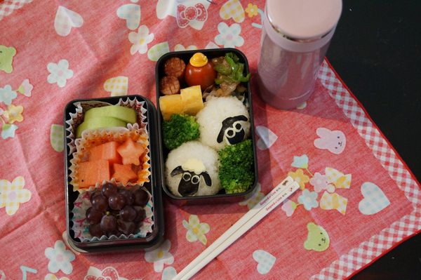 """""""Shaun the Sheep rice ball is made with rice, seaweed and cheese. The bush is made with broccoli. Other parts are fried egg,"""