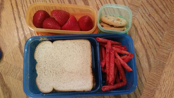 """""""I had a PB&J sandwich on honey wheat bread, fresh strawberries, Soft Batch chocolate chip cookies and Takis Fuego chips."""