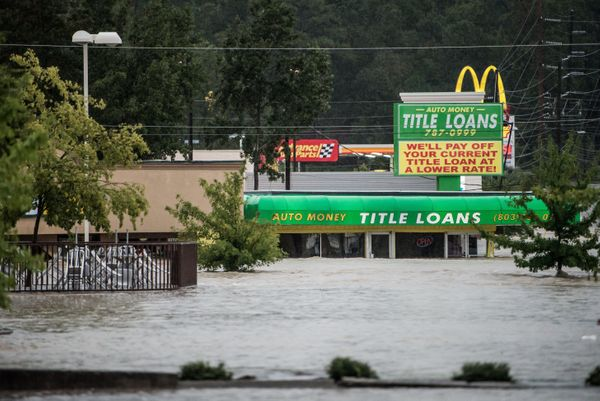 Floodwaters rise around a title loan store on Garners Ferry Road in Columbia, South Carolina.