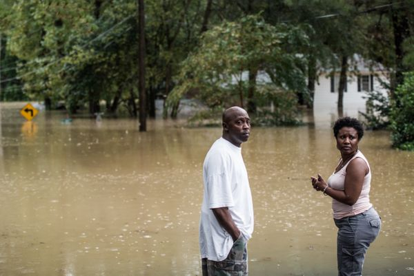 Farrell Rose and his fiancee, Damita Trapp, look away after floodwaters surrounded their home in Columbia, South Carolina.