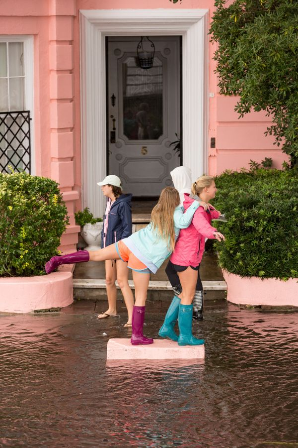 A group of college students play along the flooded streets ofCharleston, South Carolina.