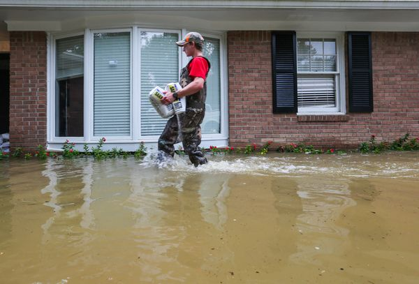 Matt Howard puts down some sandbags in hopes of reducing the damage tohis girlfriend's home in the St. Andrews area of