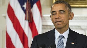 WASHINGTON, USA - OCTOBER 2: US President Barak Obama speaks during a press conference at the White House in Washington, USA on October 2, 2015. During the press conference he announced the resignation of Arnie Duncan as Secretary of Education and appointed John King as his temporary replacement. He also answered question on gun control, Russia, and the situation in Syria. (Photo by Samuel Corum/Anadolu Agency/Getty Images)