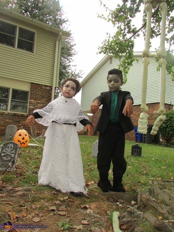 "Via <a href=""http://www.costume-works.com/costumes_for_kids/mr_n_mrs_frankenstein.html"" target=""_blank"">Costume Works</a>"