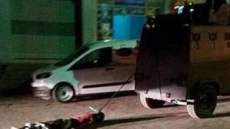 Photos of a man being dragged through the street by Turkish authorities made the rounds on social media over the weekend.