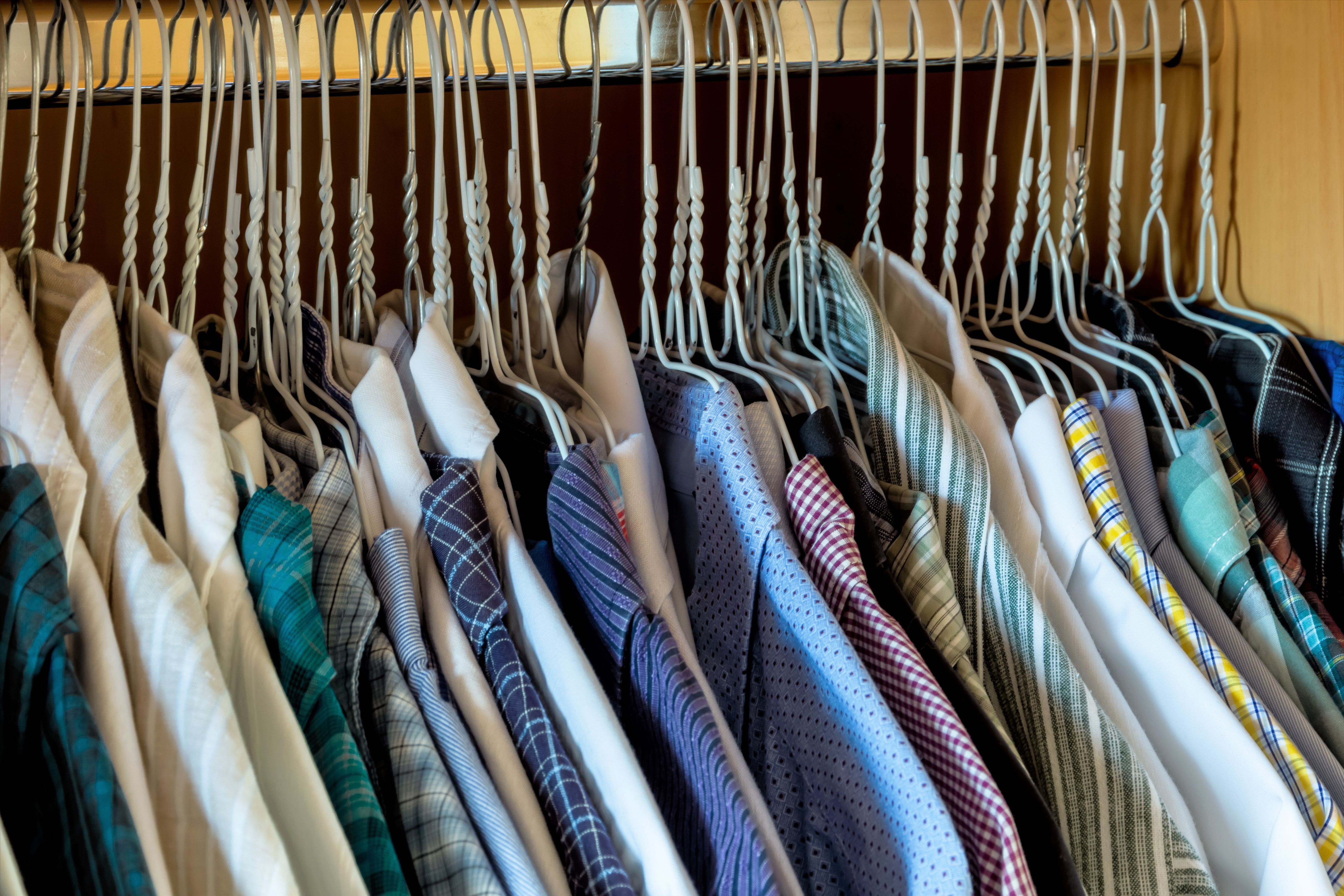 bedroom box with men's shirts on hangers, selection and order