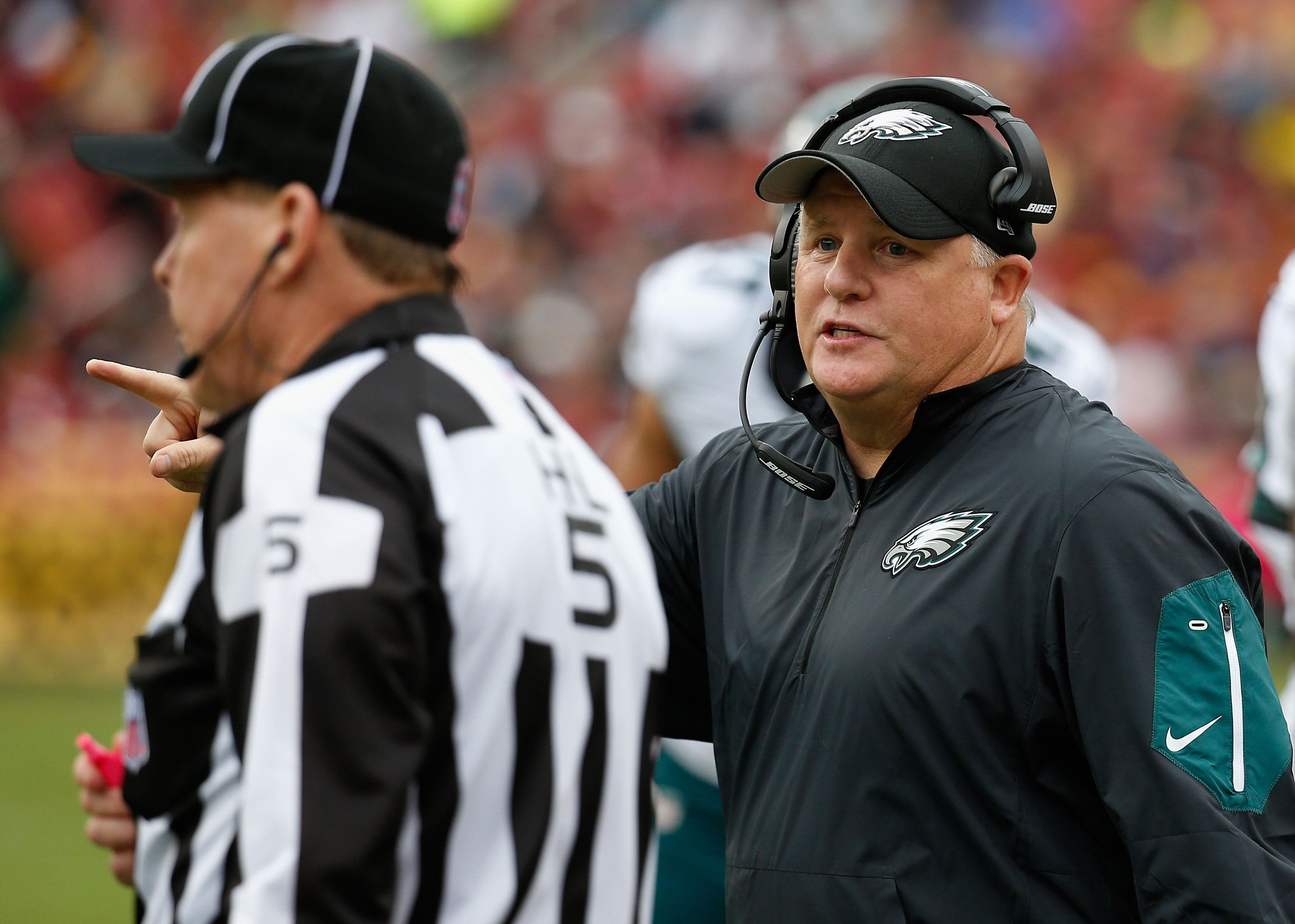 LANDOVER, MD - OCTOBER 04: Head coach Chip Kelly of the Philadelphia Eagles talks with an official during the second half of the Eagles 23-20 loss to the Washington Redskins at FedExField on October 4, 2015 in Landover, Maryland.  (Photo by Rob Carr/Getty Images)
