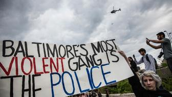 BALTIMORE, MD - MAY 01:  A police helicopter monitors protesters marching in support of Maryland state attorney Marilyn Mosby's announcement that charges would be filed against Baltimore police officers in the death of Freddie Gray on May 1, 2015 in Baltimore, Maryland. Gray died in police custody after being arrested on April 12, 2015.  (Photo by Andrew Burton/Getty Images)
