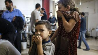 DAMASCUS, SYRIA - JULY 27: Syrian children receives treatment at a field hospital following a chlorine gas attack by Assad regime forces in Ayn Tarma town of Damascus, Syria on July 27, 2015. (Photo by Ala Muhammed/Anadolu Agency/Getty Images)