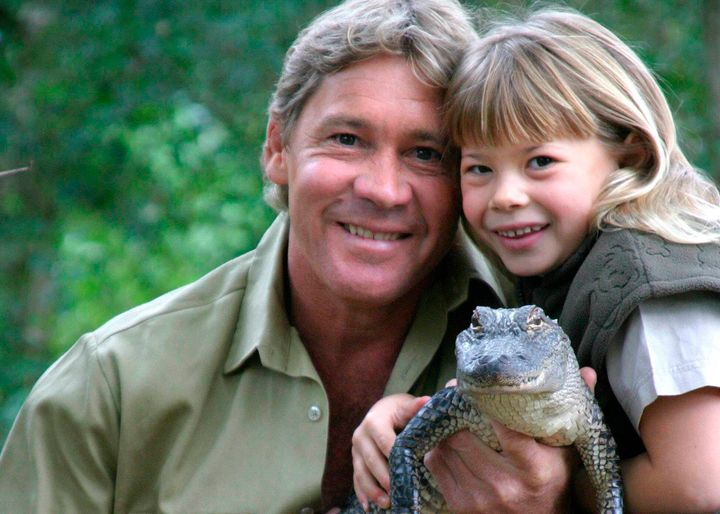 "Bindi poses with her father and ""Russ"" the alligator at Australia Zoo in June 2005."