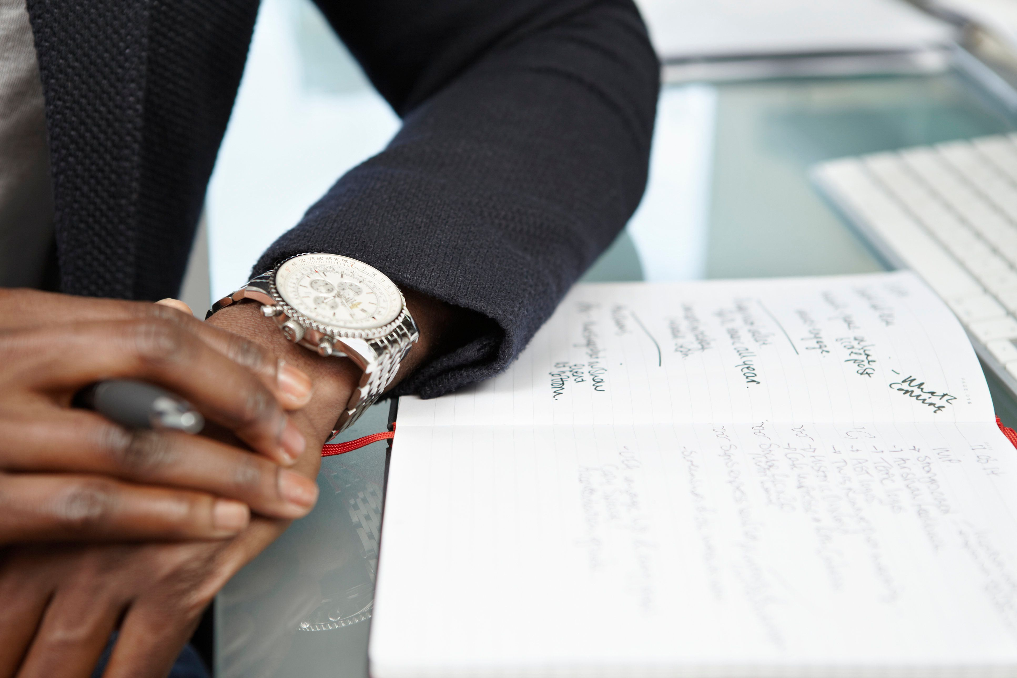 Businessman looking at watch in creative office