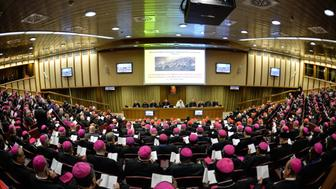 A general view shows bishops, cardinals and Pope Francis (C) during the second morning session of the Synod on the Family at the Vatican on October 6, 2015.    AFP PHOTO / ANDREAS  SOLARO        (Photo credit should read ANDREAS SOLARO/AFP/Getty Images)