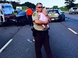 Deputy Comforts Baby At Scene Of Traffic Accident