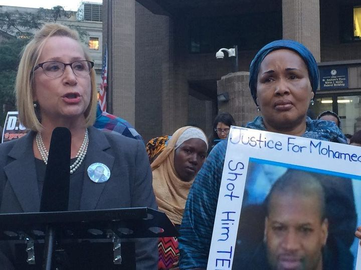 Debra Cohen and her client Hawa Bah, mother of Mohamed Bah, speak at a rally on Oct. 7, 2015 in lower Man