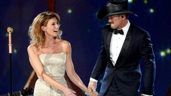 LAS VEGAS, NV - APRIL 06:  Singer/songwriters Faith Hill (L) and Tim McGraw perform onstage during the 49th Annual Academy of Country Music Awards at the MGM Grand Garden Arena on April 6, 2014 in Las Vegas, Nevada.  (Photo by Ethan Miller/Getty Images)