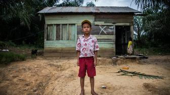 Four years after a forced eviction from ancestral land, the father of 9-year-old Revan Pragustiawan says his son is traumatized and afraid to meet people.