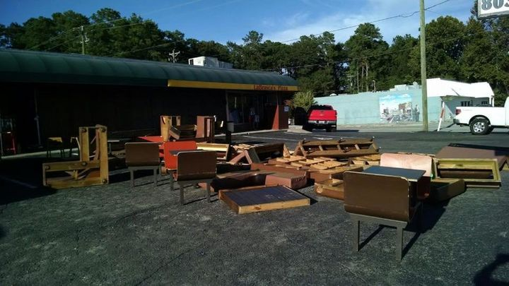 Furniture and interior pieces from LaBrasca's dry in the sun outside.
